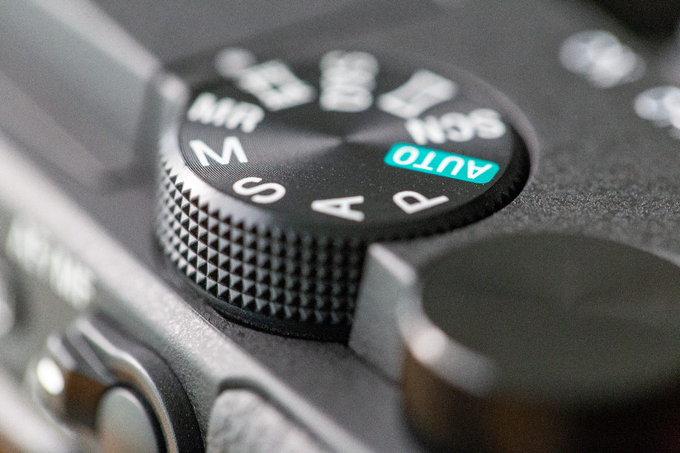 digital camera controls dials knobs buttons equipment technology settings macro cloesup photography gear