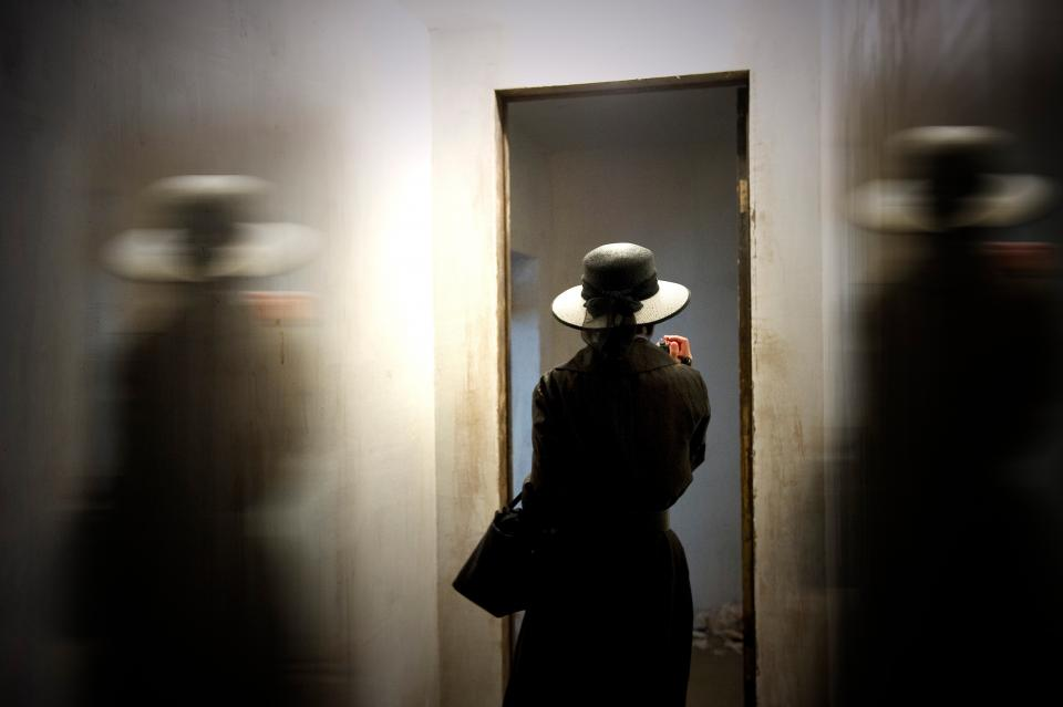people girl alone black hat fashion inside wall door dark