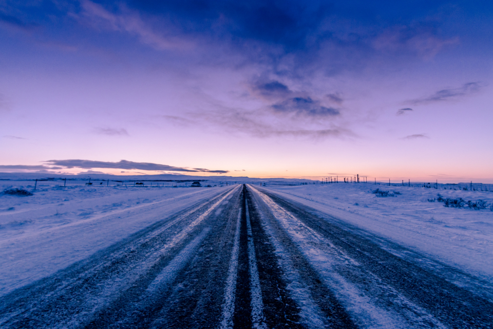 frozen winter road landscape rural snow ice freezing asphalt sky clouds nature outdoors outside dusk slippery