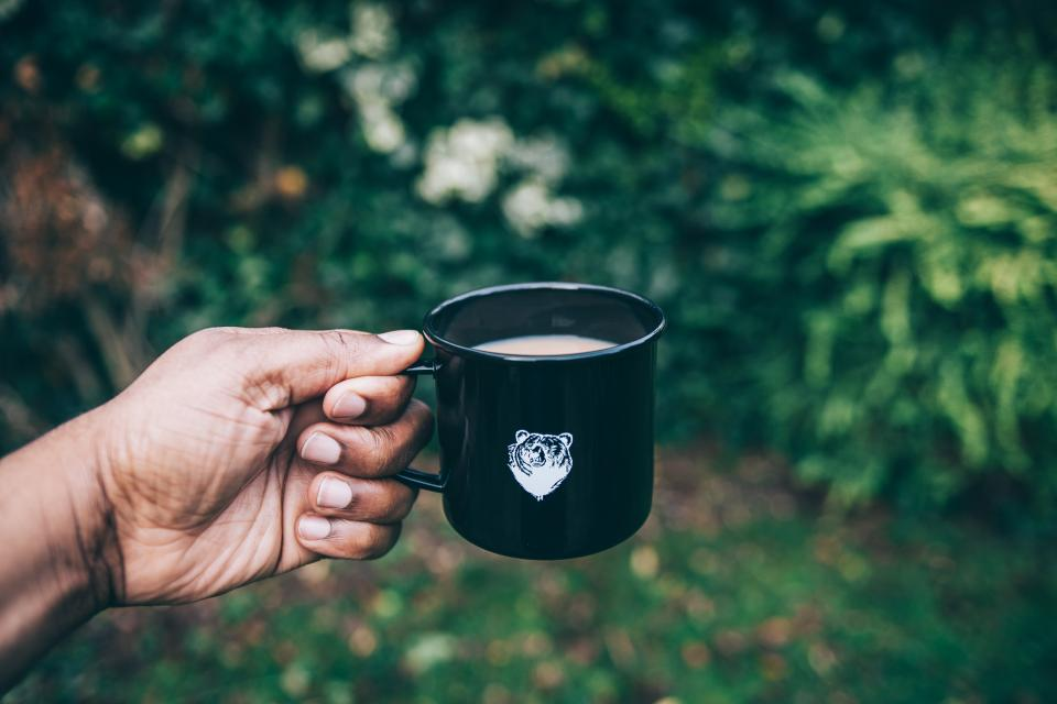 coffee mug drink hand green plant nature bokeh outdoor