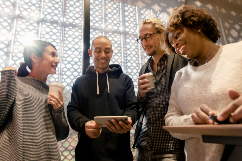 african american asian caucasian cellphone cheerful communication community connecting connection data device digital drink electronic ethnicity european friends gadget global happiness information innovation internet man media mobil
