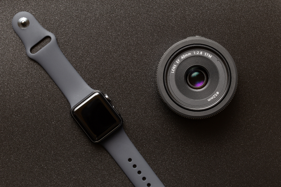 apple watch technology wearable camera lens gear smartwatch dark space gray texture flat lay top background focus macro close up equipment accessories device digital gadget wireless