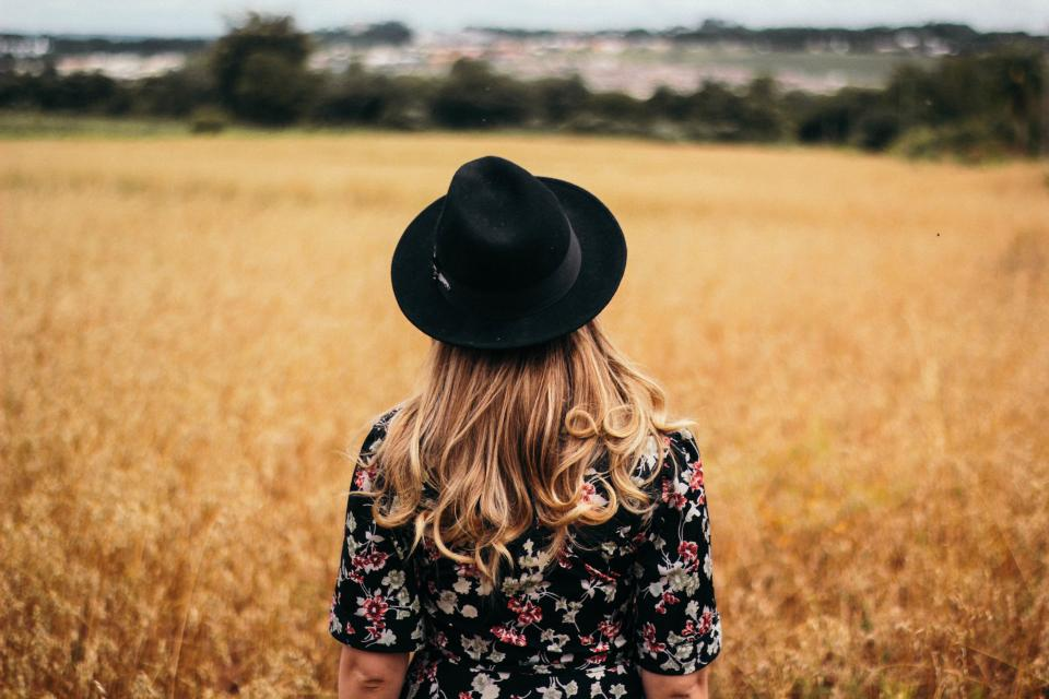people girl woman alone hair cap hat fashion autumn fall grass field bokeh