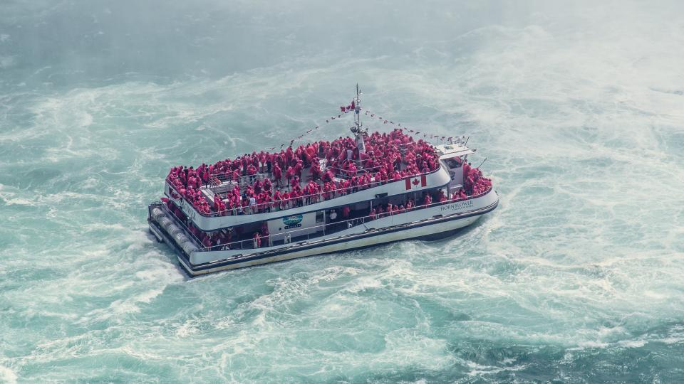sea ocean water waves nature boat ship sailing people passengers travel trip transportation crowd
