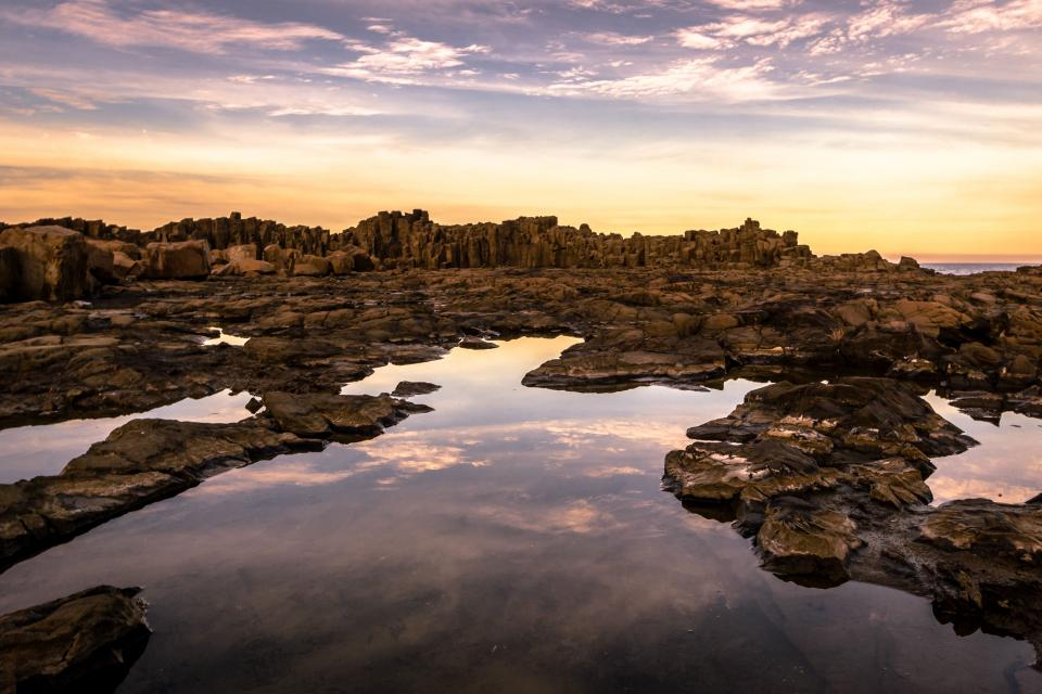nature landscape rocks water reflection sky clouds horizon gradient