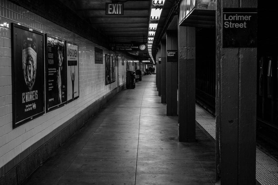 NYC subway underground transportation platform New York City urban black and white
