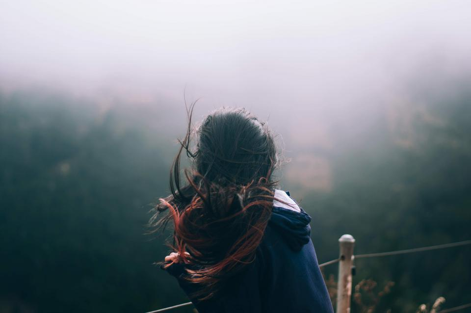 woman girl lady people back contemplate stand hair waves sway nature cliff fog travel