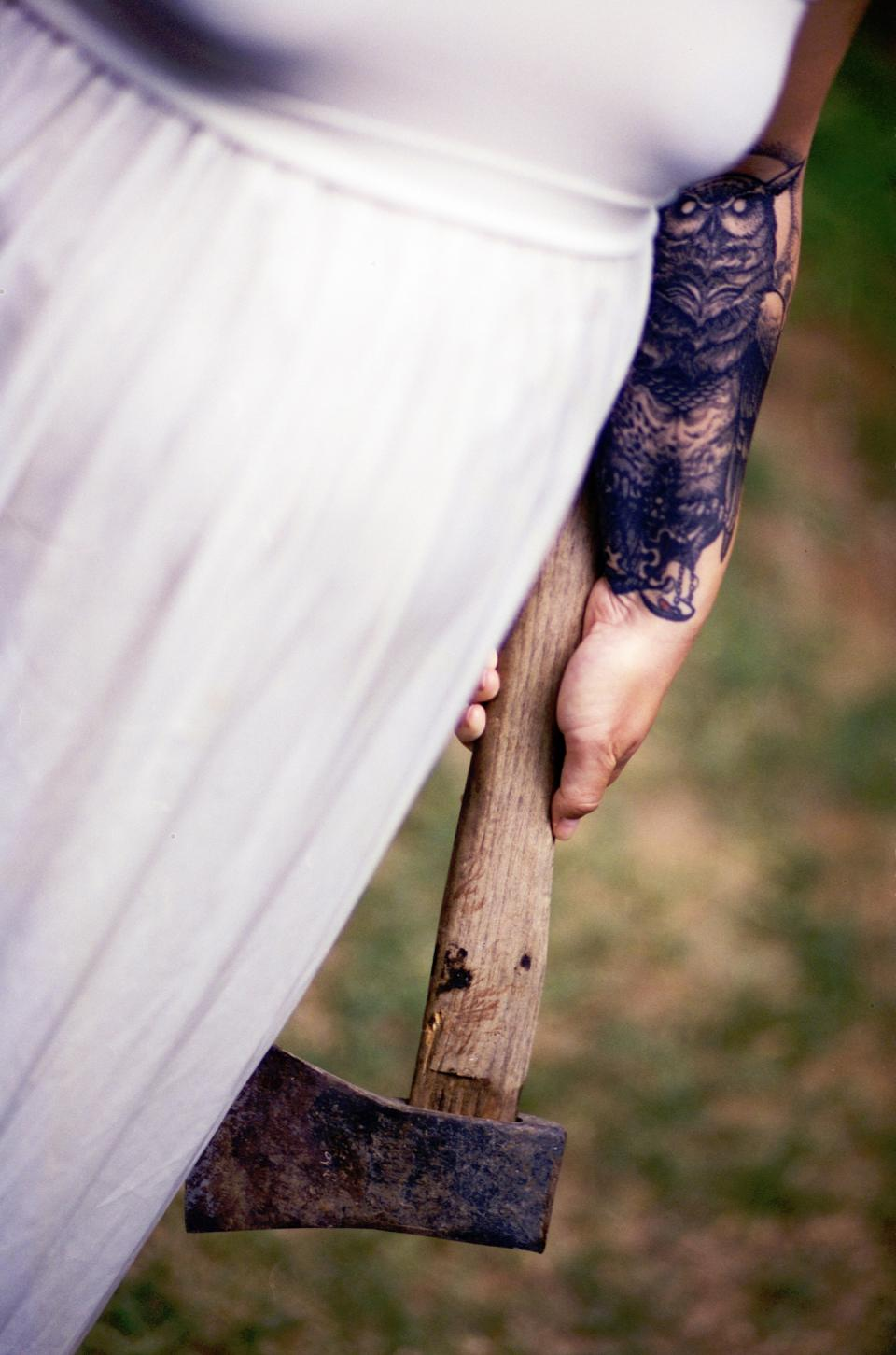 weapon wood ax people hand owl tattoo