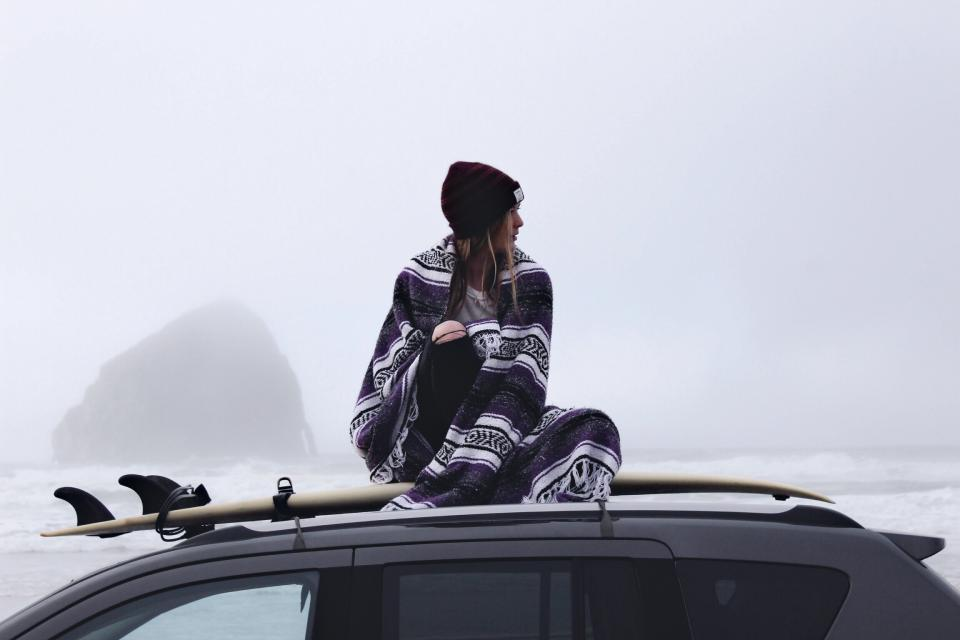 people woman cold weather fog car vehicle top load water ocean sea waves