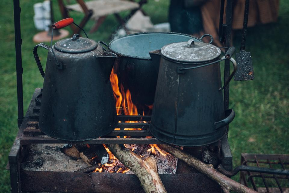 fire flame kettle steel firewood food field ration green grass