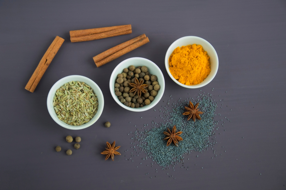 spices ingredients turmeric cinnamon seeds pepper anise poppy cuisine food cooking fragrant dark background