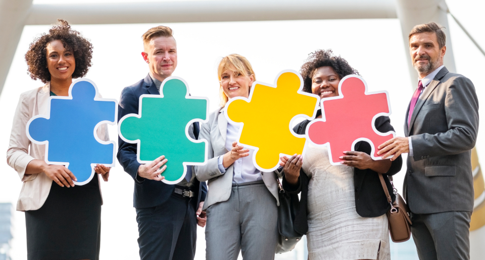 business colleagues bridge businesswoman businessman man woman male female people standing posing city urban connected corporate diverse diversity downtown smile company conference leadership meeting professional together team