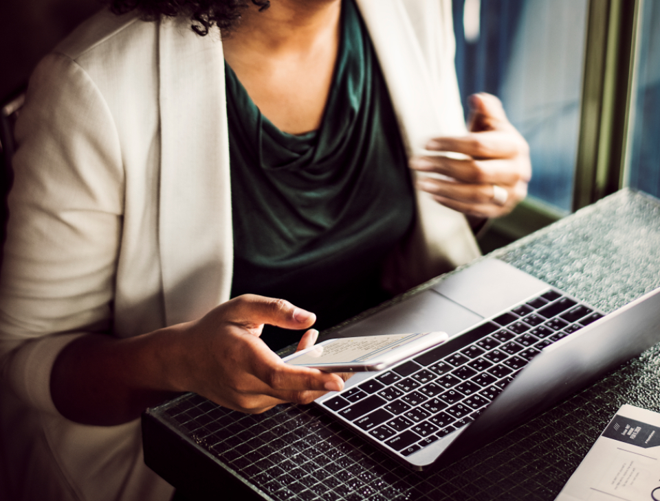 businesswoman laptop phone adult african american afro alone black business busy cafe close up communication computer digital device employee focus holding mobile phone person plan professional sitting