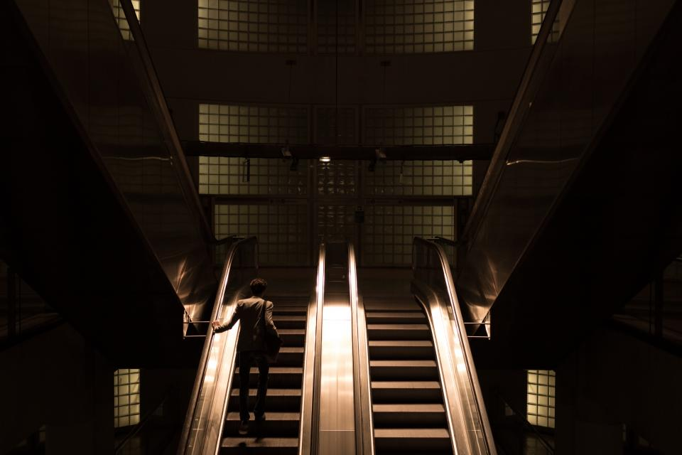 architecture building infrastructure escalator establishment dark night people alone man light