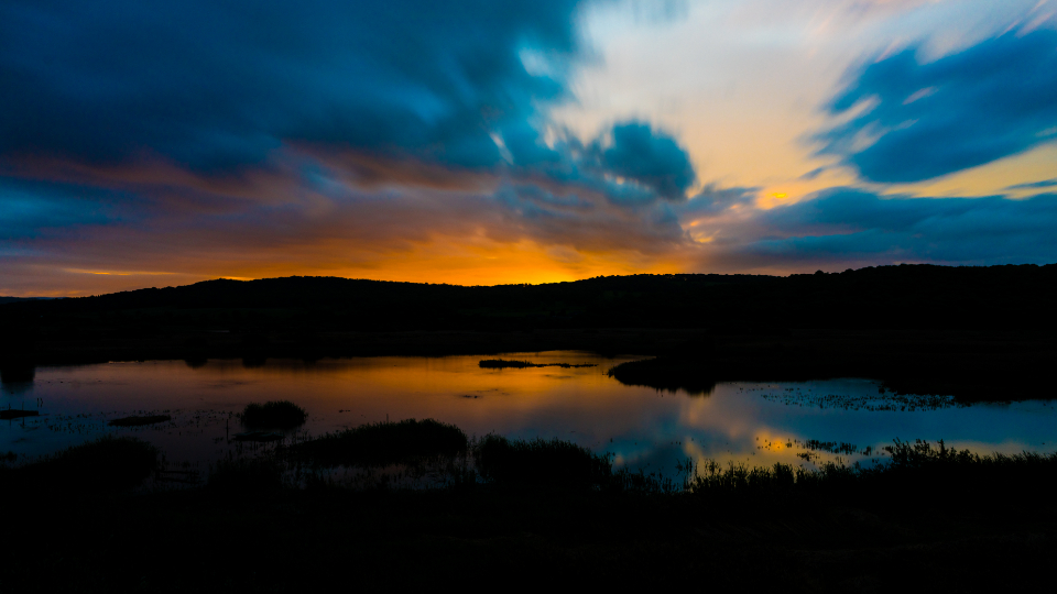 sunset dawn dusk nature sky sunrise water lake clouds golden marsh mountains landscape dramatic outdoors sun motion