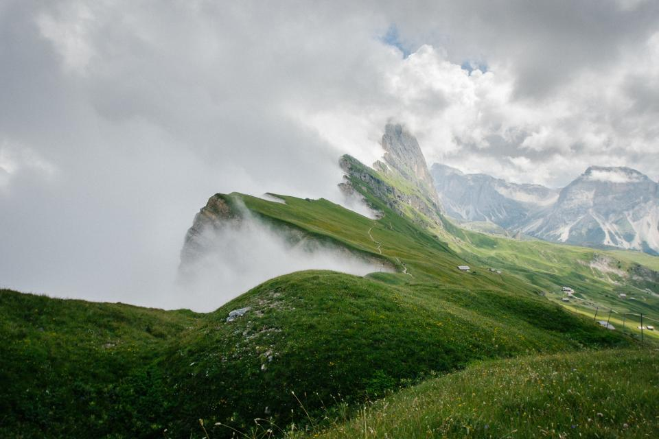 mountain view fog sky clouds house people travel trip adventure landscape plants grass rocks fence nature