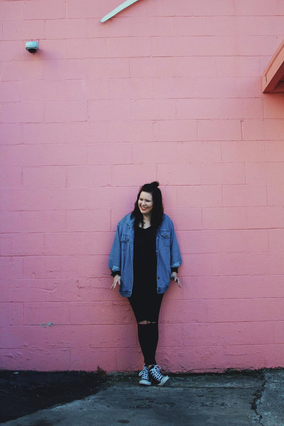 people woman fashion denim pink wall happy smile enjoy
