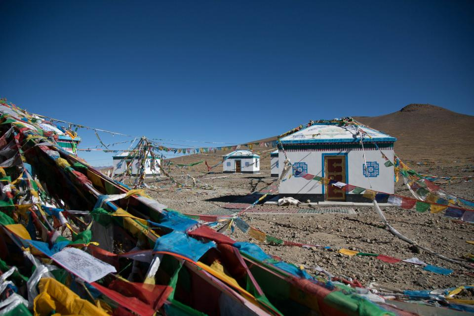 blue sky highland mountain landscape outdoor colorful tibet house