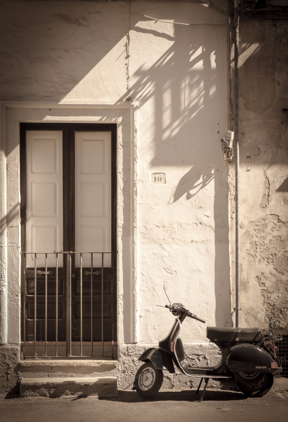 scooter door doorstep dolce vita italy sepia vespa vintage transportation house home stone entrance black and white city architecture building