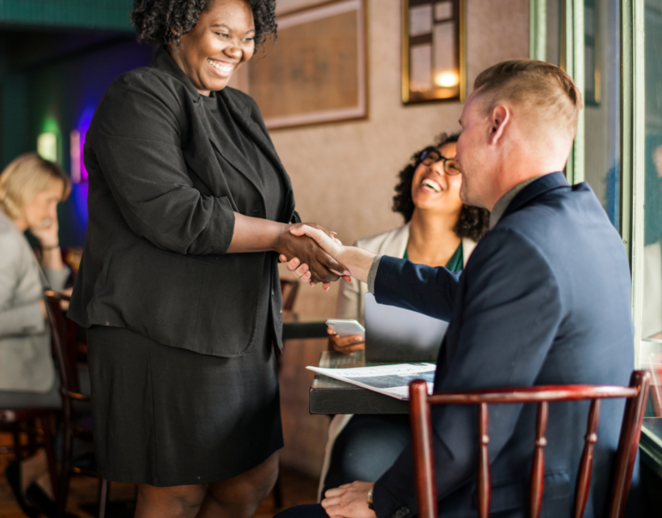 african american agreement business businessman businesswoman cafe casual coffee coffee shop collaboration colleague communication drink greeting hands handshake happy help helping helping hands