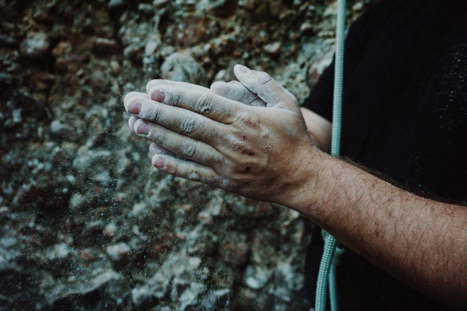 people man hand arm clap sand rock blur