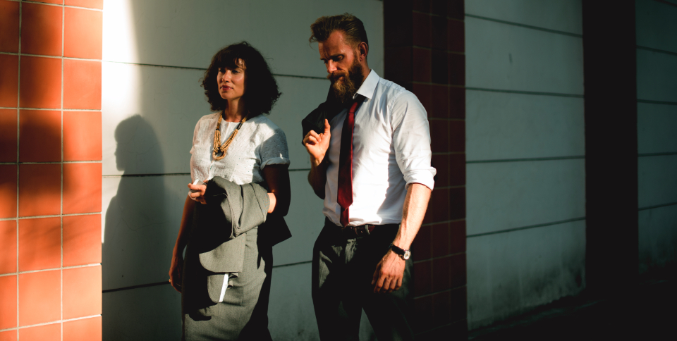 walking street commuter business city connection togetherness colleague corporate suit beard