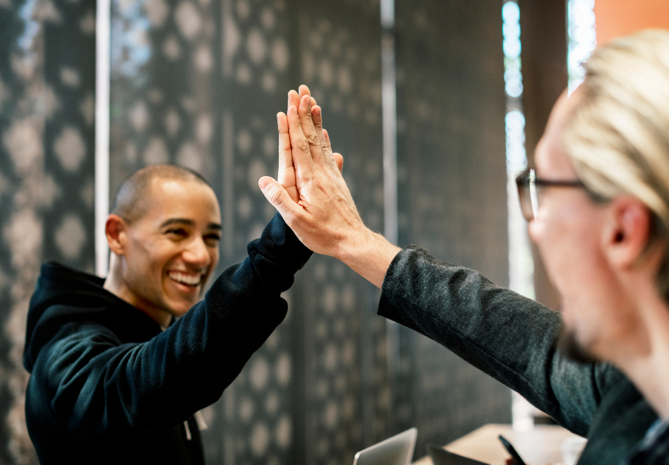 achievement agreement cheerful colleague communication cooperation deal diverse european expression friends greeting group hands happiness high five hit man meeting partners partnership people power smiling success support team team building te