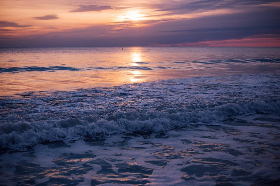 sea ocean water waves nature sunset cloud sky beach shore coast