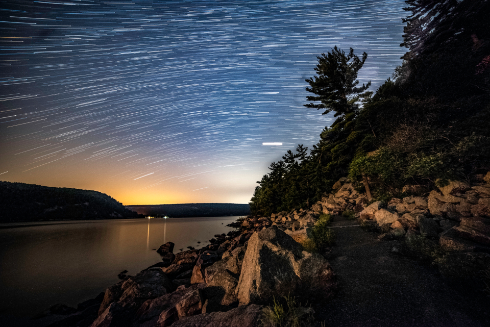 night sky star trails landscape rocks lake scenery darkness astrophotography