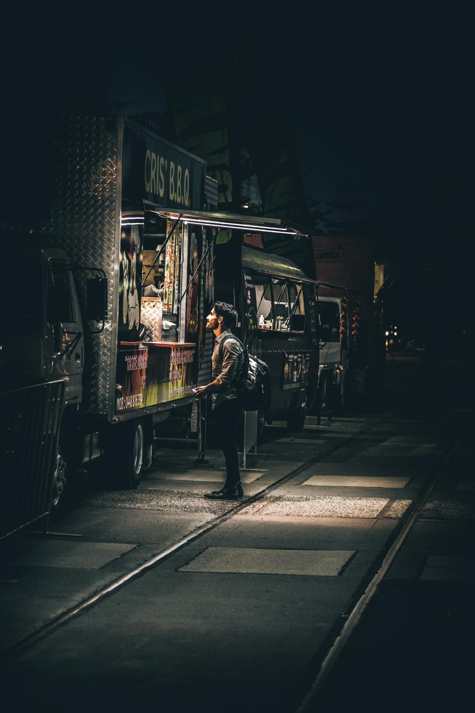 people man vendor store shop dark night alone truck
