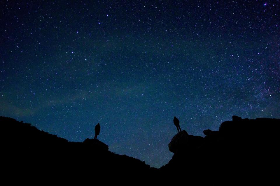 dark night sky stars mountain highland landscape nature silhouette people men travel outdoor adventure hiking