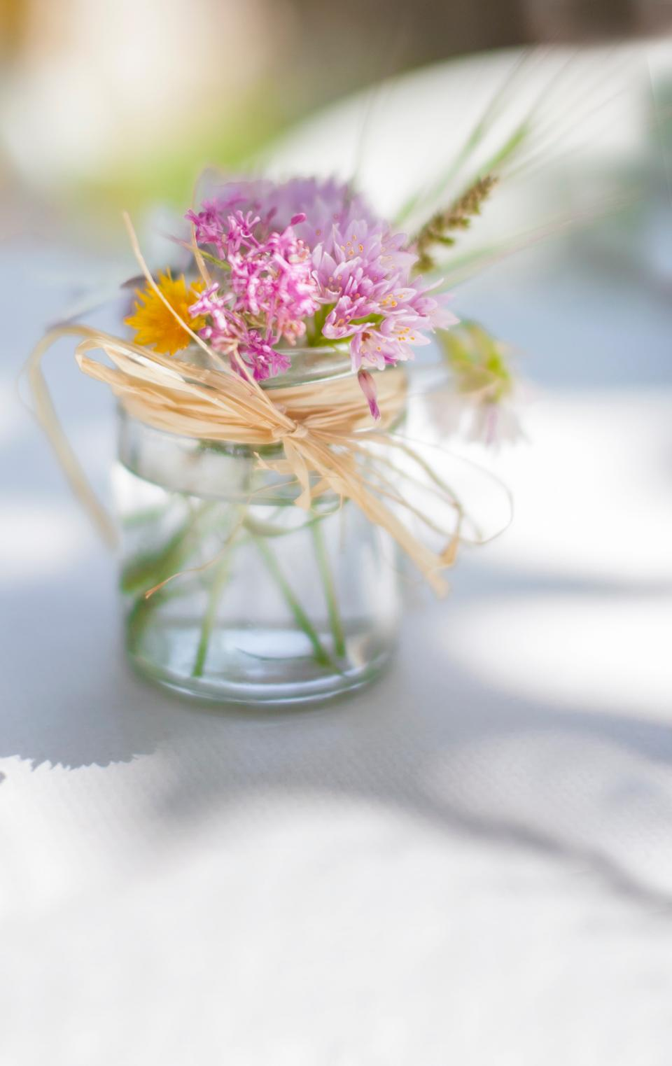 flowers glass water ribbon bokeh blur petals. lavender white nature