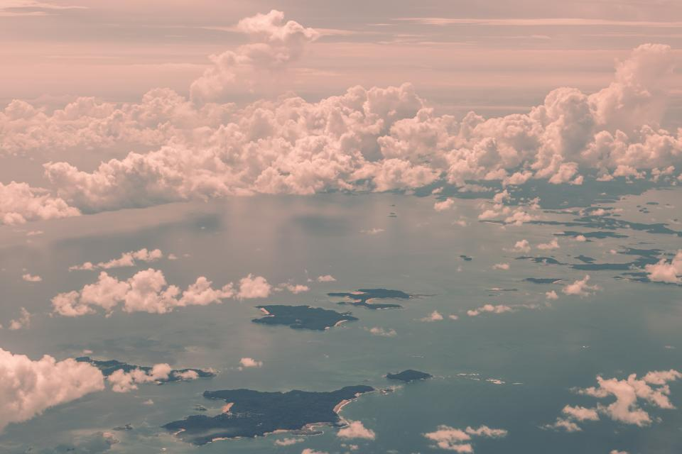 sea ocean water aerial view clouds sky nature island