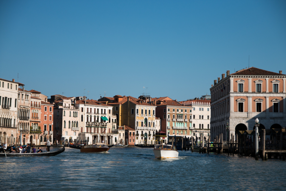 Venice sea boats blue sky buildings city architecture travel vacation italy europe