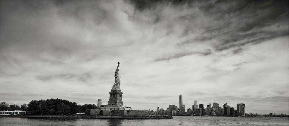 statue of liberty liberty island New York city NYC skyline buildings architecture sky black and white