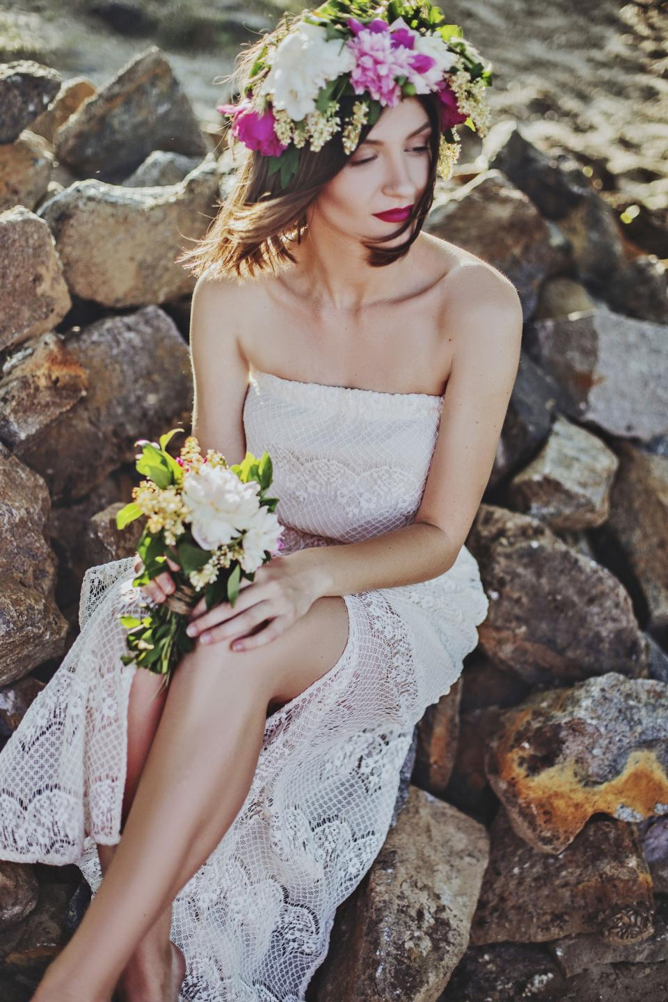 people woman wedding dress bouquet rock stone flowers crown