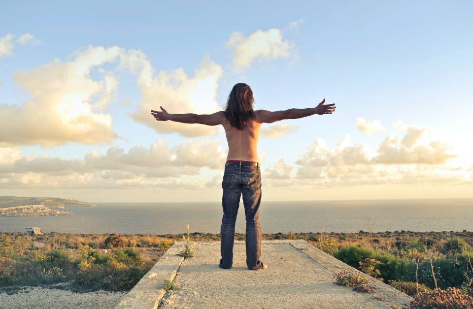 freedom man outdoors blue sky jeans topless arms embrace happy nature