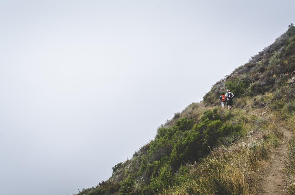 hiking trekking fitness outdoors people backpacks trail hill foggy nature mountain hill sky