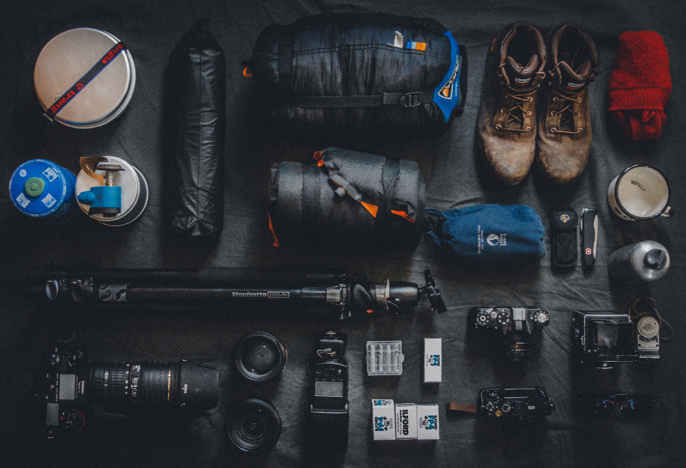 photographer travel essentials accessories camera lens sleeping bag camping journey adventure boots wallking hiking gas burner jacket coat photography