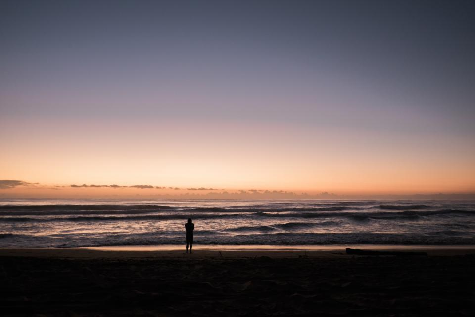 sea ocean water waves nature beach shore coast sunset silhouette people alone horizon