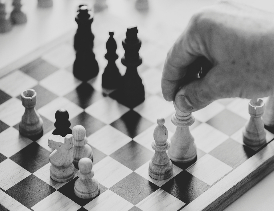 black and white business strategy challenge chess closeup competition decision english european game german gray scale grayscale hands help isolated on white mind game mind games performance pers
