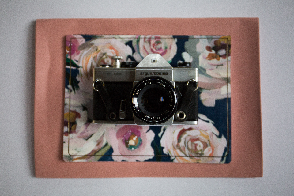 camera top view flat lay vintage film 35mm old retro analog photography lens antique art object