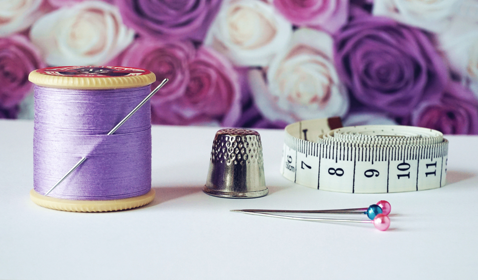 sewing cotton thread cotton reels lilac measuring tape thimble pins crafts