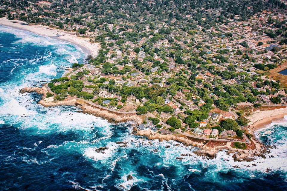 houses buildings trees plants nature landscape aerial view rocks sea ocean blue water coast beach