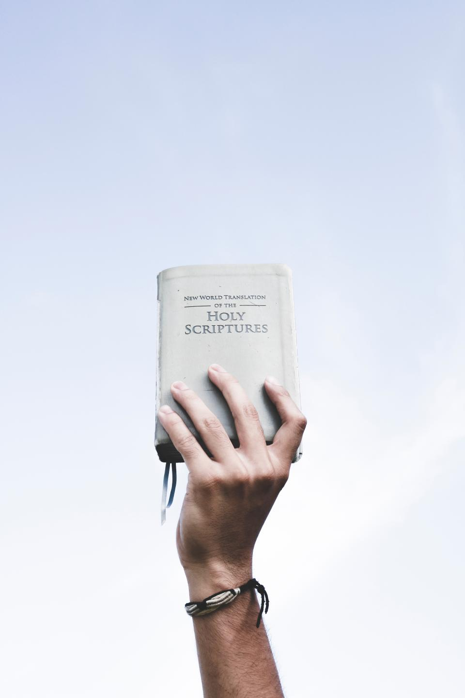 holy book bible scriptures reading hand