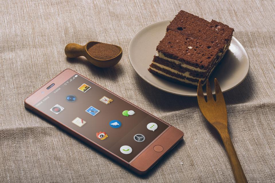 mobile phone electronic gadget modern technology touchscreen dessert chocolate food snack tiramisu cake fork