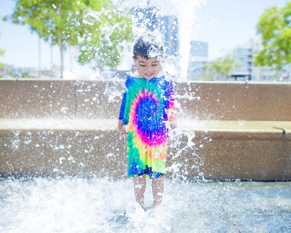 water fountain people kid swimming child boy smile happy play