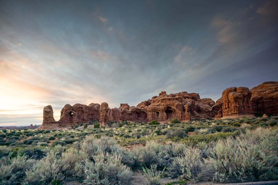 landscape nature desert arizona canyon rocks grass national park sky sand clouds outdoor valley arid