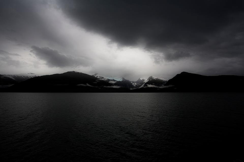 sea ocean water nature mountain sky clouds black and white
