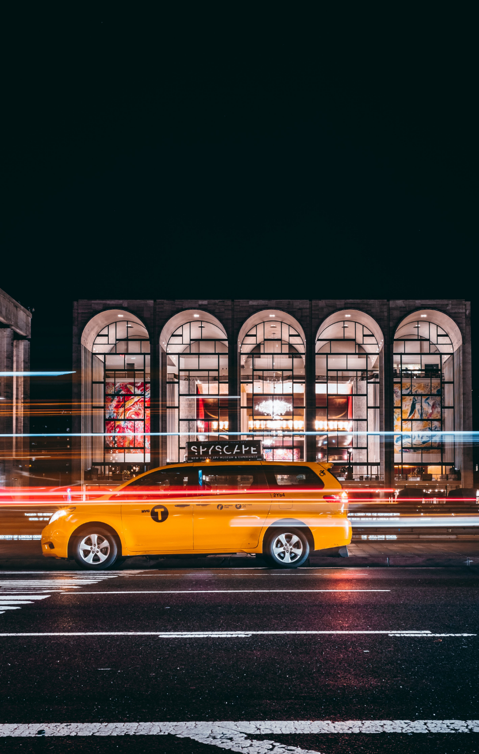 taxi city night cab motion lights blur street building auto urban life yellow car abstract movement driving